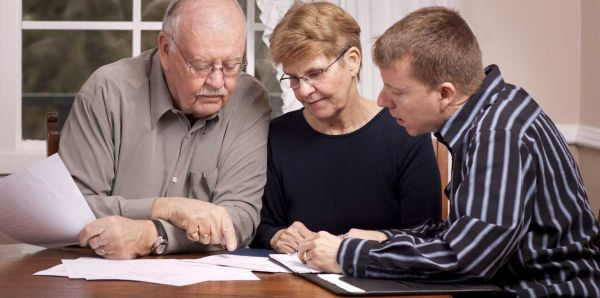 Parents making property investment decision with child